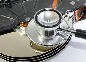 hard disk infected with computer virus with syringe and stethosc