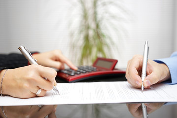 lawyer and client completing contract and prices