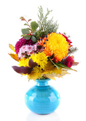 Flower bouquet in blue vase isolated on white