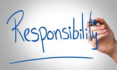 Responsibility hand writing with a blue mark