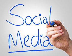 Social Media hand writing with a blue mark