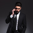 Front view of a young business man talking on the phone