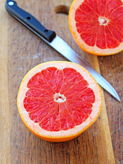 Grapefruit halves on wooden plank