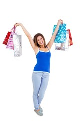 Festive young woman holding shopping bags