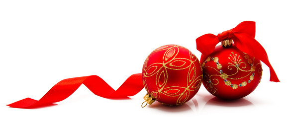 Two red christmas balls with ribbon isolated on a white