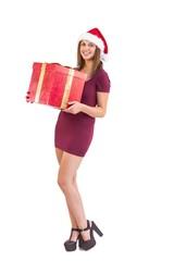 Festive brunette holding christmas gift