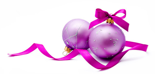 Two lilac christmas balls with ribbon isolated