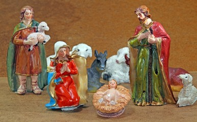 Mary and Joseph with the child Jesus in the manger with a shephe
