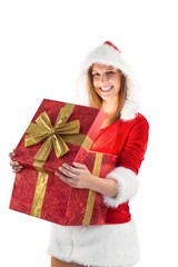 Festive pretty brunette opening a gift