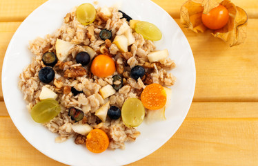 oat muesli with physalis, blueberry and grape