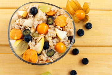 tasty oatmeal porridge or muesli with berries