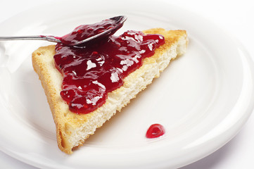 Toast bread with raspberry jam
