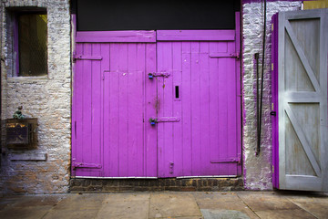 Purple barn type doors on building exterior