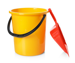 Yellow bucket and red scoop isolated on white background