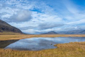Scenic view of wild Icelandic landscape with lake.