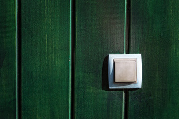 push button on wooden wall
