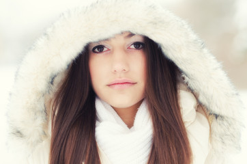 Portrait of the beautiful girl in winter landscape