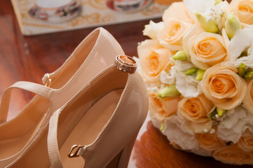 wedding rings and bridal bouquet and shoes