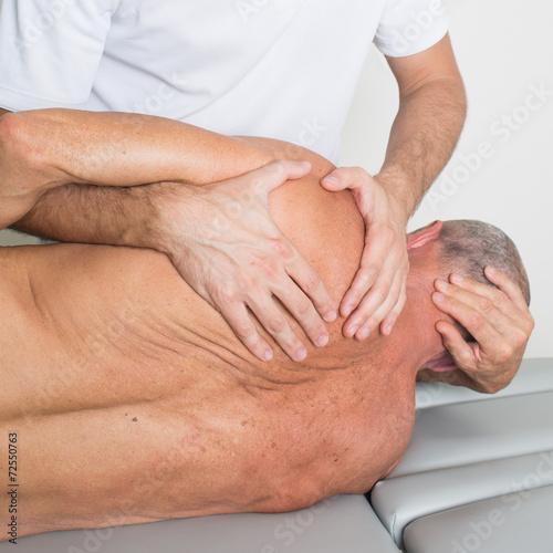 canvas print picture Manipulation dorsal bei aelterem Patienten