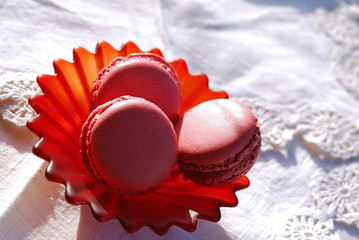 Macaroons on a small red saucer