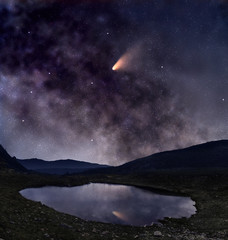 Comet over mountain lake