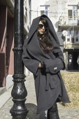Women in wool jacket on a street