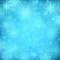 Blue shiny Christmas background with snowflakes