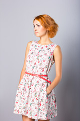 Beautiful young girl in a short dress.
