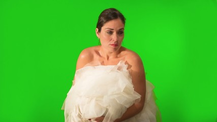 Bride running away and holding her dress. Shot on Green Screen