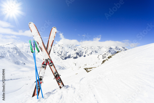 Ski , mountains and ski equipments on ski run