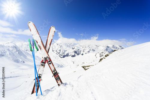 Ski , mountains and ski equipments on ski run