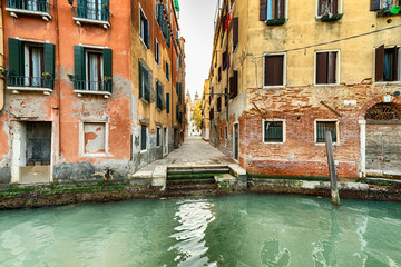 Narrow street and canal in Venice, Italy