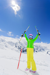 Ski, winter fun, lovely skier girl enjoying ski vacation