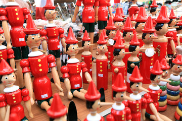 Painted wooden souvenir dolls of the figure of Pinocchio