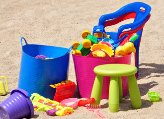 Children's plastic toys in the sand