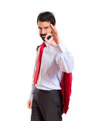 Businessman dressed like superhero making Ok sign
