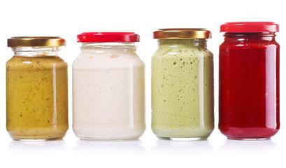 jars of preserved mustard, ketchup, horseradish