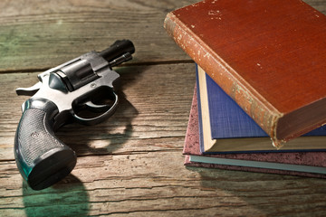books and handgun