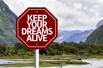 Keep Your Dreams Alive written on red road sign