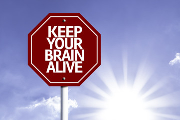Keep Your Brain Alive written on red road sign