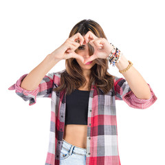 Girl making a heart with her hands over white background