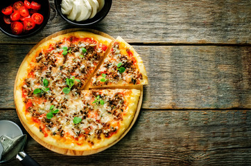 pizza with meat, mozzarella and oregano