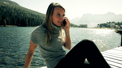 Angry beautiful blond woman on the phone