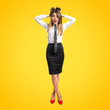 Pretty businesswoman frustrated over yellow background