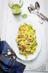 Pasta with pesto and prosciutto ham
