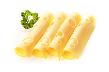 Rolled slices of cheese garnished with parsley
