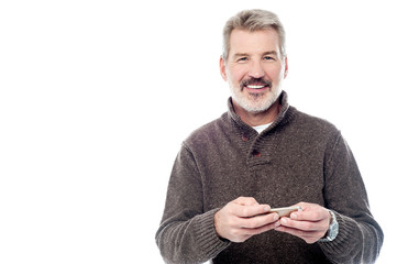 Smiling mature man with mobile phone