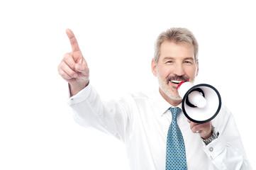 Businessman making an announcement by loudhailer