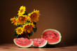 Sunflowers in a vase and watermelon