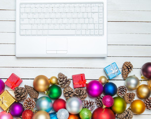 White laptop and christmas toys.